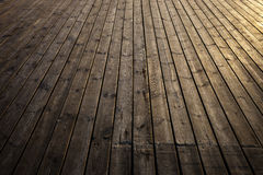 Wooden planks in early morning light Stock Images