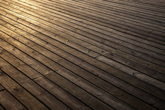 Wooden planks in early morning light Royalty Free Stock Photo