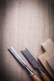 Wooden planks and firmer chisels on wood background copy space c Royalty Free Stock Photography