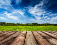 Wooden planks floor  and summer meadow Royalty Free Stock Photography