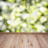 Wooden planks with green background Royalty Free Stock Photos