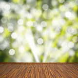 Wooden planks with green bokeh background Stock Photos