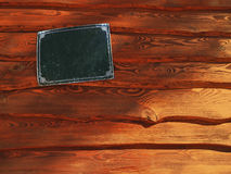 Wooden planks with nameplate. Iron nameplate on red wooden planks Royalty Free Stock Photos