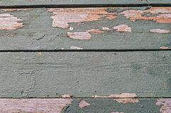 Wooden planks painted with green paint. Peeling paint on old boards. Background for different use. stock image
