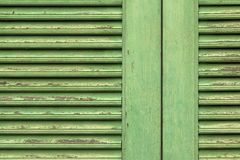 Wooden planks painted old green. Old painted wooden wall texture or background with copy space. Green window on old traditional house royalty free stock photography