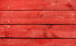 Wooden planks painted in red Stock Image