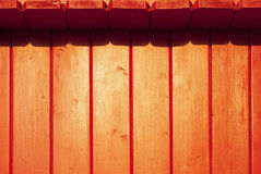 Wooden planks painted red. Construction of red wooden planks reflecting yellow sunset light royalty free stock photography