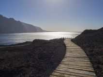 Wooden planks path leading to the sea shore with view on hight l royalty free stock photos