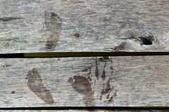 Wooden planks with prints of bare feet Royalty Free Stock Image