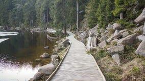 Wooden planks round way around lake stock images