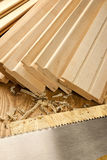 Wooden planks with saw Royalty Free Stock Images