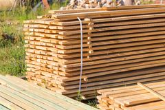 Wooden planks from sawmill for house roof construction Stock Image