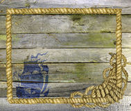 Wooden planks with sea rope and ship Stock Photos