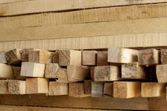 Wooden planks stacked in rows Royalty Free Stock Photography