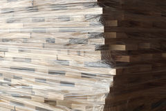 Wooden planks stacked in rows wrapped in plastic foil Royalty Free Stock Image