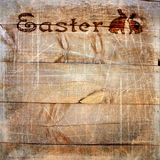 Wooden planks with stamping Easter, scratches and texture Stock Image
