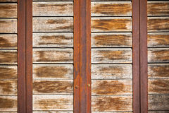 Wooden planks surface with rusty metal bands background Royalty Free Stock Image