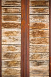 Wooden planks surface with rusty metal bands background Royalty Free Stock Images