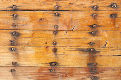Wooden planks tightened with Nails and roves Royalty Free Stock Images