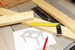 Wooden planks with tools and table draft on tablesaw Royalty Free Stock Photos