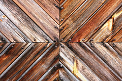 Wooden planks wall texture. Slant, converging wooden boards tile and rusty nails - pattern. Old slav house wall Royalty Free Stock Photo