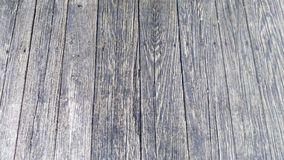 Wooden Planks of a Weathered Bridge. The textured weather worn planks of a wooden foot bridge Royalty Free Stock Photos