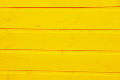 Wooden planks of wood painted yellow Stock Image