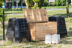Wooden and plastic compost boxes Royalty Free Stock Photos