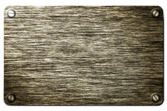 Wooden plate. Image of wooden plate screwed on the wall Stock Images
