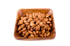 Wooden plate with almonds. Square wooden plate with almonds Stock Photo