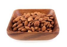 Wooden plate with almonds Stock Photos