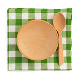 Wooden plate at checked napkin Royalty Free Stock Images
