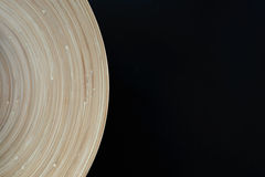 Wooden plate curvature on black background Royalty Free Stock Photography