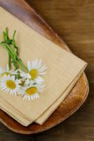 Wooden plate and daisy Stock Photo