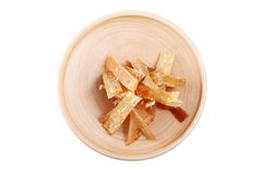 Wooden plate with dried fish, isolated image on white background Stock Image
