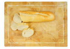 Wooden plate with french bread. Royalty Free Stock Photography