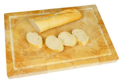 Wooden plate with french bread Stock Photography
