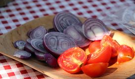 Wooden plate with fresh vegetables Royalty Free Stock Photo