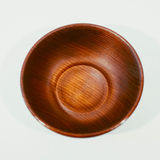 Wooden plate on a light background. A wooden bowl on the table.  on white background Royalty Free Stock Photo