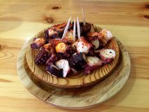 Wooden plate of octopus galician style Stock Image