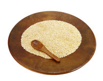 Wooden plate with organic quinoa Stock Image