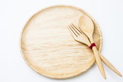 Wooden plate,spoon and fork isolate Royalty Free Stock Image