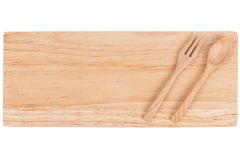 Wooden plate with spoon and fork Stock Photography