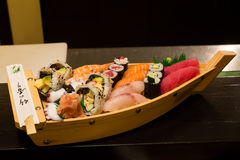 Wooden plate with sushi. Royalty Free Stock Photography