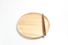 Wooden plate or tray with chopsticks isolated white background. Wooden plate or tray with chopsticks isolated on white background Royalty Free Stock Image