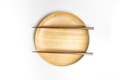 Wooden plate or tray with chopsticks isolated white background. Wooden plate or tray with chopsticks isolated on white background Stock Photography