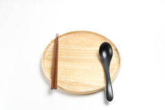 Wooden plate or tray with chopsticks and spoon isolated white background. Wooden plate or tray with chopsticks and spoon isolated on white background Stock Images