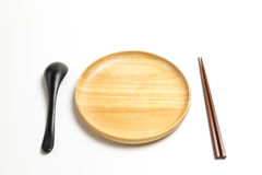 Wooden plate or tray with chopsticks and spoon isolated white background. Wooden plate or tray with chopsticks and spoon isolated on white background Royalty Free Stock Photo