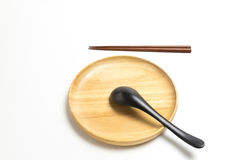 Wooden plate or tray with chopsticks and spoon isolated white background. Wooden plate or tray with chopsticks and spoon isolated on white background Royalty Free Stock Photography
