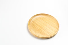 Wooden plate or tray isolated white background. Wooden plate or tray isolated on white background Stock Images